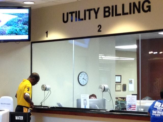 Customer Standing at Utility Billing Counter
