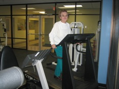 Woman Walking on Treadmill