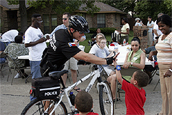 Bike Patrol Officer Greets a Young Child